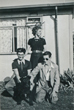 Brian and his best man and Brian's mother and the dog outside the prefab 8/8/1953