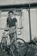 Brian aged about 13 with his bicycle outside the prefab 8/8/1953