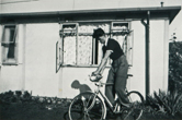 Brian in the garden of the prefab with his bicycle 8/8/1953