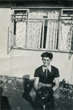 Bryan in front of prefab with dog 8/8/1953